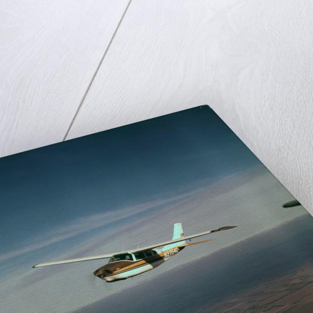 Cessna 210 Centurion Flying by Corbis
