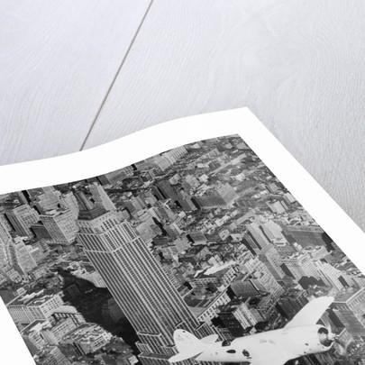 Hawks Airplane in Flight over New York City by Corbis