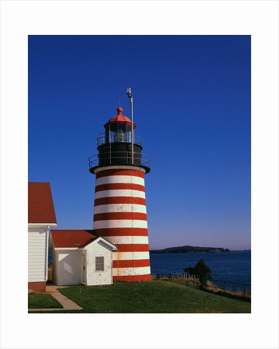 Red and White Striped Lighthouse by Corbis
