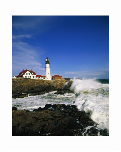 Lighthouse on Coastline by Corbis
