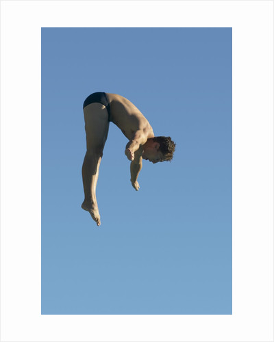 Profile shot of a young man diving by Corbis
