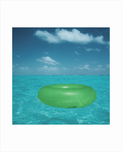 Inflatable rubber ring floating in the sea by Corbis