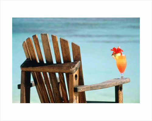 Seychelles, Denis Island, beach chair and fruit cocktail by Corbis