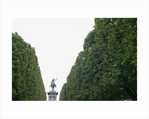 Equestrian statue between trees, Paris, France by Corbis