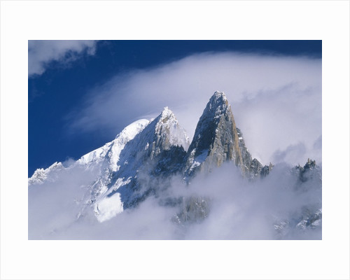 France, Alps, Mont Blanc Massif, Aiguille Verte, peak in clouds by Corbis