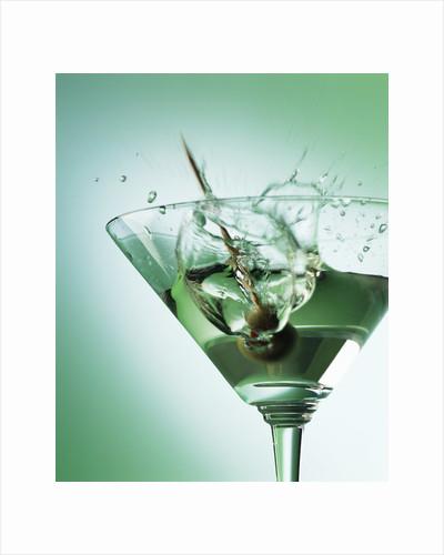Martini with Olive Splash by Corbis