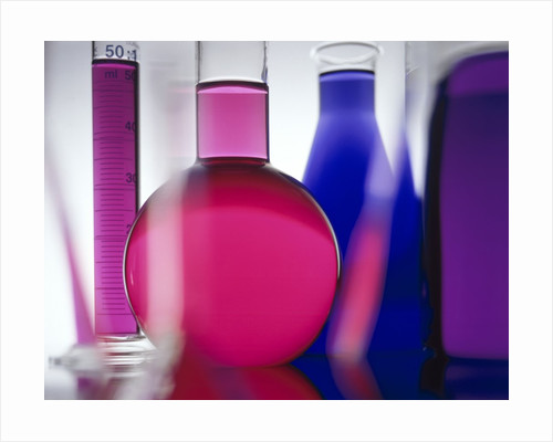 Beakers filled with liquid by Corbis