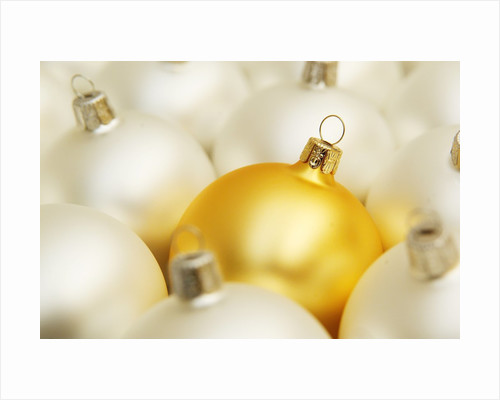 White Christmas tree decorations and a yellow one by Corbis
