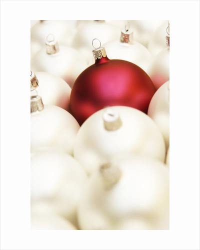 White Christmas tree decorations and a red one by Corbis