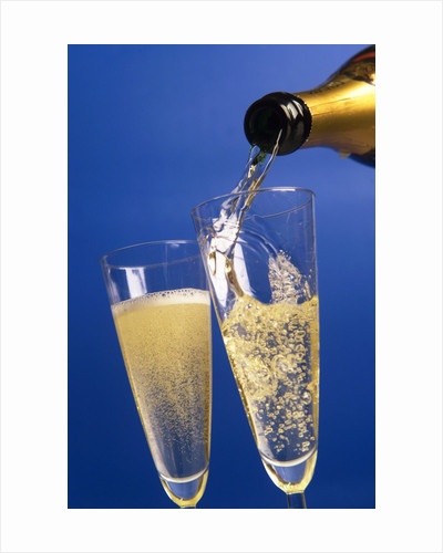Champagne glass and bottle by Corbis