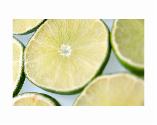Limes in slices by Corbis