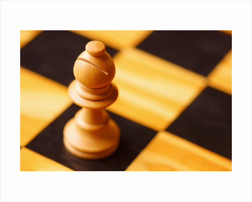 Pawn on chessboard by Corbis