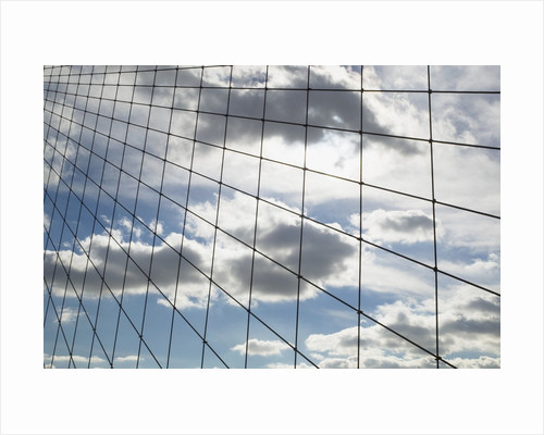 Sky seen through suspension cables by Corbis