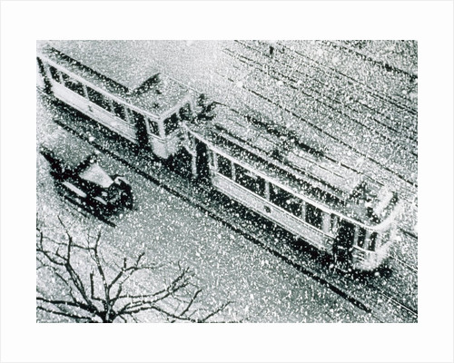 Urban traffic during snowfall, historic photo by Corbis