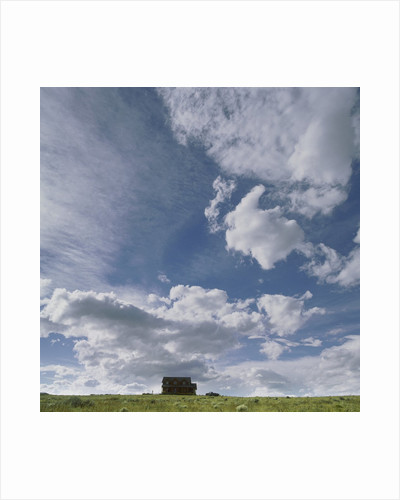 Distant house in rural setting by Corbis