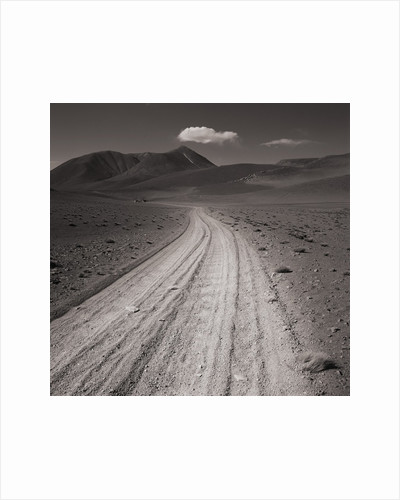 Road leading through desert setting by Corbis