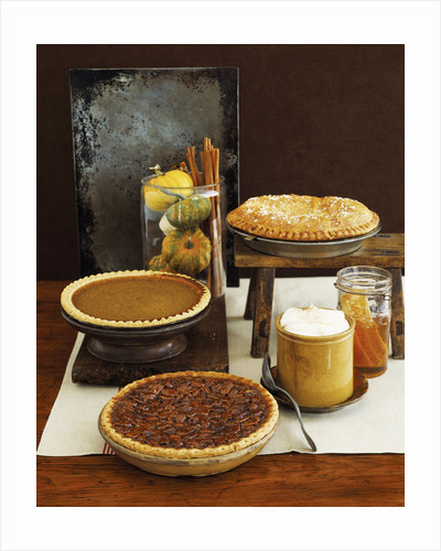 Autumn Pies: Apple/Pear, Pumpkin, and Pecan with Honey and Whipped Cream by Corbis