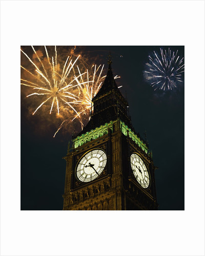 Low angle view of Big Ben, London, England, with fireworks bursting overhead by Corbis