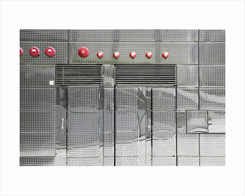 Abstract view of metal wall with red bells on it by Corbis