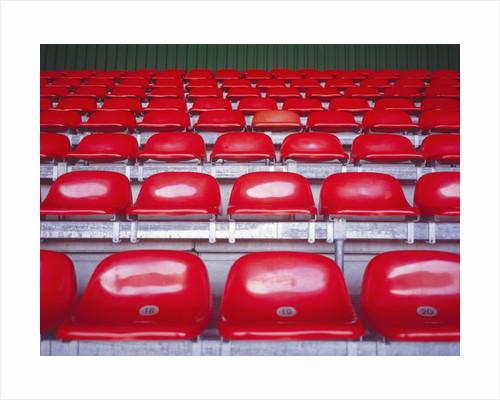 Rows of Empty Seats in Stadium by Corbis
