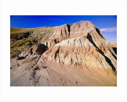 Red Rock Butte in Red Desert by Corbis