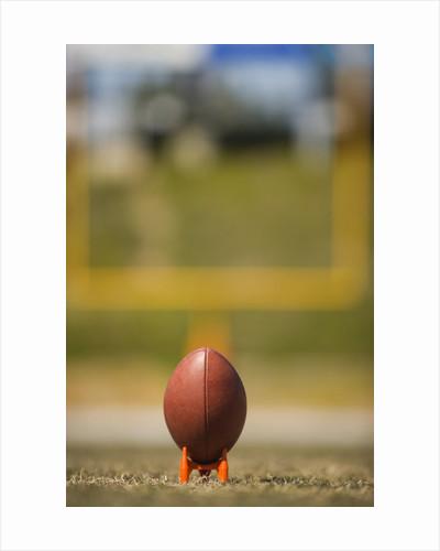 Football on Tee by Corbis