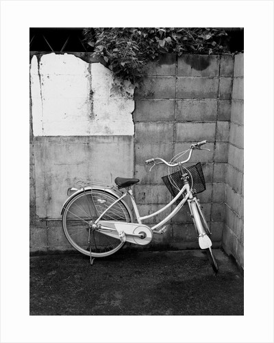 Bicycle in Courtyard by Corbis
