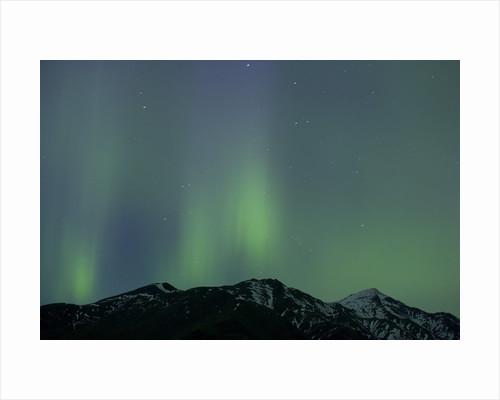 Aurora Borealis over Mountain Range by Corbis