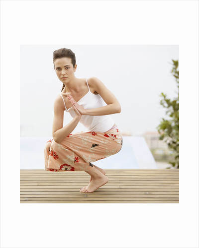 Woman Practicing Yoga by Corbis