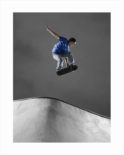 Skateboarder Performing Tricks by Corbis