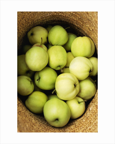 Green Apples in a Straw Hat by Corbis