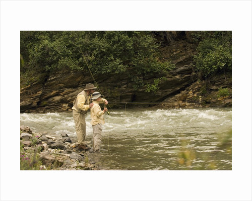 Father and Son Fly Fishing in Moose Creek by Corbis