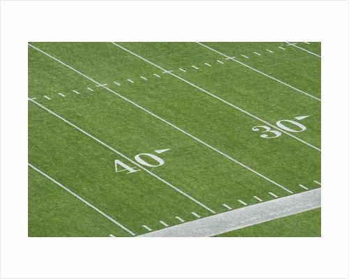 Yard Lines on Football Field by Corbis