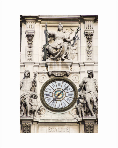 Clock on Facade of Notre Dame Cathedral by Corbis