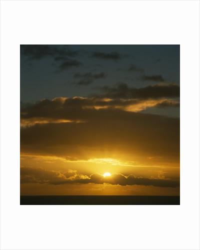 Sun in Cloudy Sky by Corbis