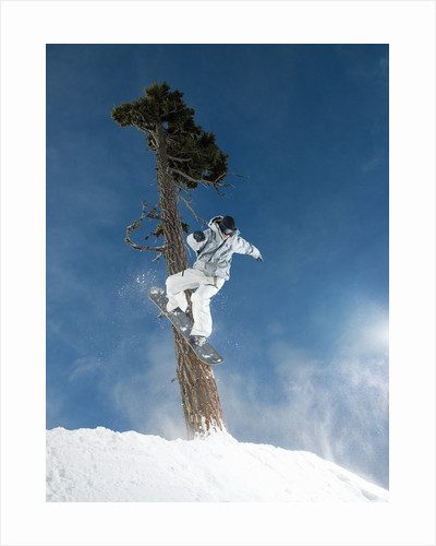 Snowboarder Mid-Air During Jump by Corbis
