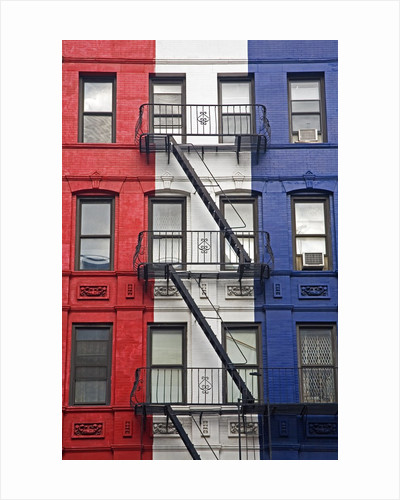 Red, White, and Blue Apartment Building by Corbis