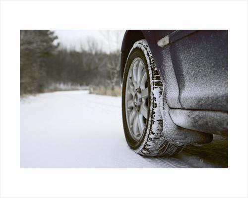 Car on Rural Road in Winter by Corbis