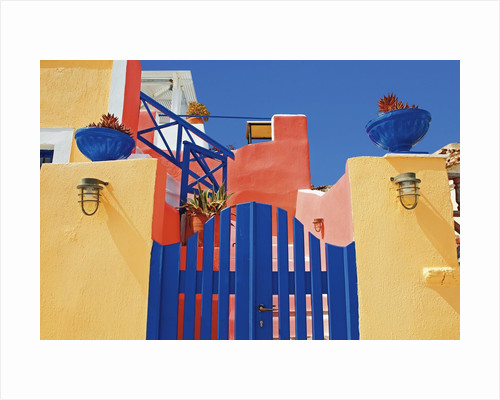 Gate to Brightly Painted House by Corbis