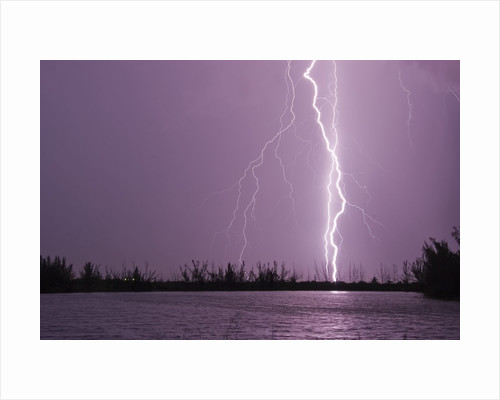 Lightning Striking near Lake by Corbis