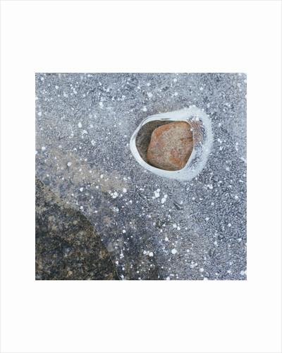 Rock in a Frozen River by Corbis