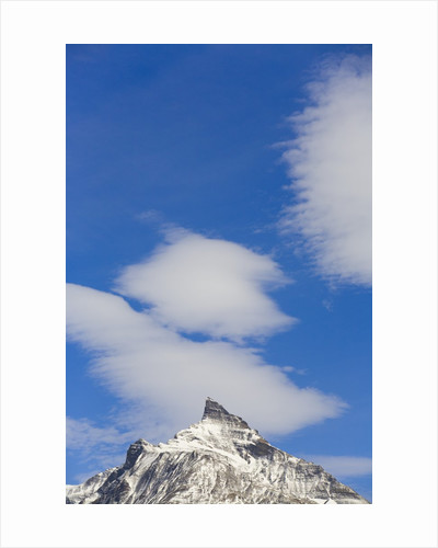 Clouds and Snowy Mountain Peak by Corbis