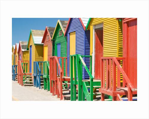 Colored Beach Huts by Corbis