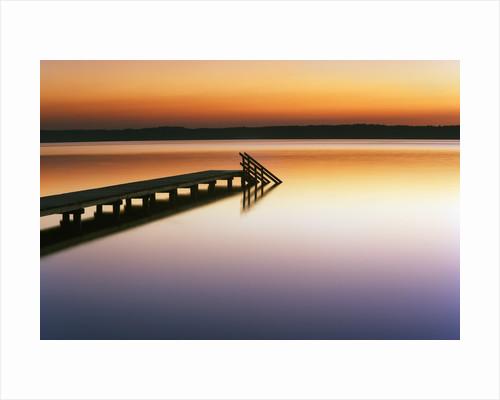 Dock on Still Lake by Corbis