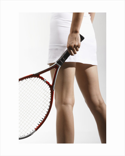 Young Woman Playing Tennis by Corbis