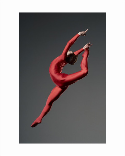 Ballet dancer in red leotard by Corbis