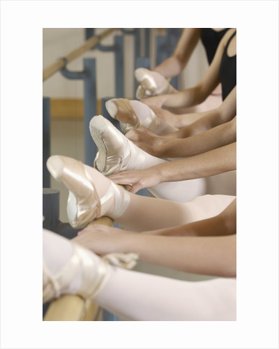 Ballerinas at the barre by Corbis