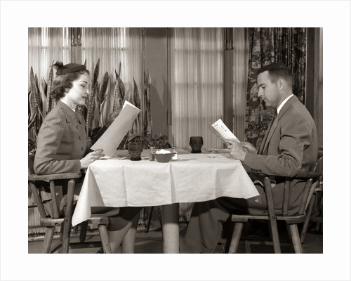 1950s Couple Man Woman Reading Restaurant Menus by Corbis