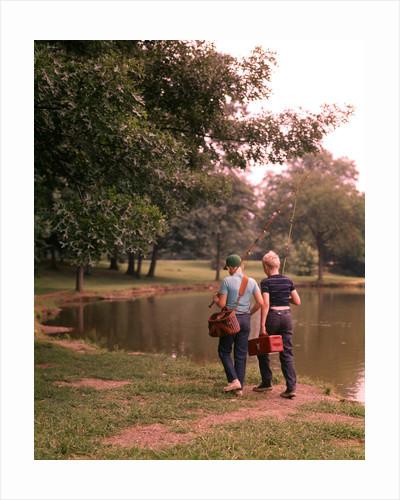 1970s 1960s Two Boys Walking Beside Fishing Pond by Corbis