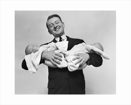 1930s Proud Father Proudly Holding Twin Babies by Corbis